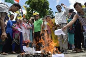Supporters of the Gorkha Janmukti Morcha (GJM) burn copies of the Gorkhaland Territorial Administration (GTA) agreement during a protest in Siliguri. The GJM wants a separate state of Gorkhaland, of which Darjeeling is a part.