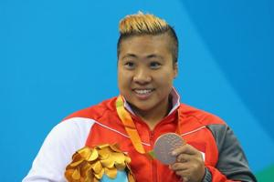 Bronze medallist Rui Si Theresa Goh of Singapore poses for the photographs on the podium at the medal ceremony for Women