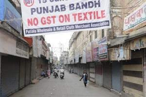 Closed shops during a protest against the implementation of GST at Adalat Bazar in Patiala on Friday.