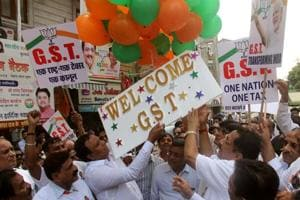 """BJP party workers with MLA Raj Purohit, Akash Raj Purohit, Ashish Shelar celebrate implementing of """"GST"""" one nation one tax which will be on effect tomorrow at Kalwadevi , in Mumbai, India, on Friday, 30 June, 2017."""