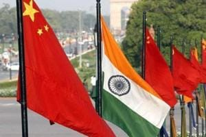 The  national flags of India and China at Rajpath in New Delhi.