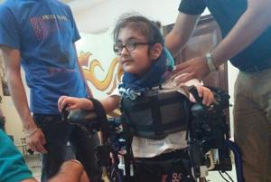Maggu's nephew Praneit, nine, trying out the exoskeleton in Delhi.