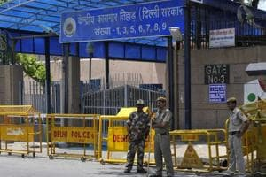 Security personnel guards the gate of Tihar Jail.