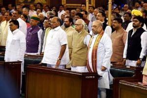 BJP leaders LK Advani and Amit Shah with NCP chief Sharad Pawar stand for the national anthem at the special ceremony in the Central Hall of Parliament for the launch of GST in New Delhi.