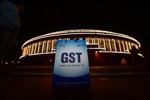 Not one but four governments and four people can be credited for the new Goods and Services Tax that was rolled out on July 1.
