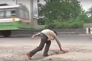 A screengrab of the Hyderabad teenager filling potholes with stones and gravels in Habsiguda area of the city.