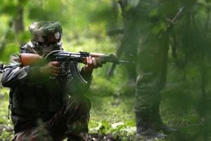 Army soldiers take position during an operation against militants in Shopian district south of Srinagar, in this file photo from May 2017.