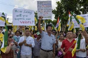 Indian supporters of the Gorkha Janmukti Morcha (GJM) chant slogans before burning copies of the Gorkhaland Territorial Administration (GTA) agreement during a protest in Dagapur village on the outskirts of Siliguri on June 27.