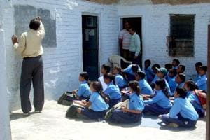 Students of a government secondary school in Rajasthan where the education department has changed the name of a scheme for meritorious girl students.