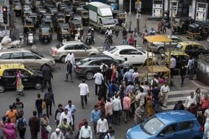 Pedestrians, autos and cars fight for space in this congested Bandra junction.