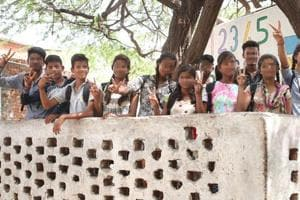 Students of the school at  a Jaipur slum, who opposed child marriage of their classmate, raise a victory sign.