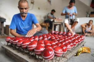 Jalandhar, India July 06: Labourer making leather ball using from cricket at Jalandhar, India on Thursday, July 06, 2017. Pardeep Pandit/HT Photo
