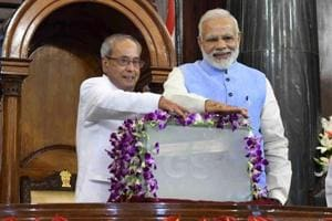 Former President Pranab Mukherjee and Prime Minister Narendra Modi press buttons for the launch of Goods and Services Tax at midnight of June 30 at the special ceremony in the Central Hall of Parliament in New Delhi.