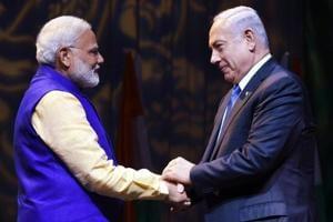 Prime Minister Narendra Modi shakes hands with Israeli Prime Minister Benjamin Netanyahu at the Community Reception Programme in Tel Aviv.