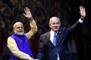 Prime Minister Narendra Modi with Israeli Prime Minister Benjamin Netanyahu at the Community Reception Programme, in Tel Aviv, Israel on Wednesday.