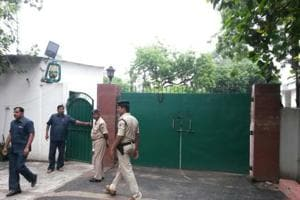 CBI and police officials outside RJD chief Lalu Prasad's residence in Patna on Friday morning.