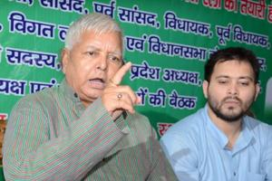 RJD chief Lalu Prasad addresses reporters in Patna, after CBI raids, on Friday. Also seen is his son Tejashwi.