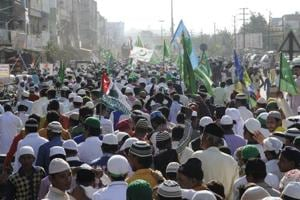 Muslims take part in a procession to mark the birthday of Prophet Mohammad. The route of the procession triggered tension between Hindus and Muslims in Bareilly in March 2010.