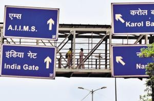 Signboards put up on a foot overbridge in Delhi. Experts say most signage in the city are wrongly placed and have bad design