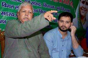 RJD chief Lalu Prasad addresses a press conference with his son and Bihar deputy CM Tejashwi Yadav at his residence in Patna.