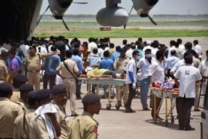 The bodies of the pilgrims killed in the Anantnag attack, at the Surat airport.