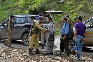 Security personnel frisking the yatris and the locals before they head towards the holy cave shrine following the militant attack on a bus at Nuwun base Camp in South Kashmir on Tuesday.