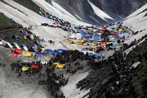 Pilgrims on a glacial campsite on the final stretch of their journey leading to the Amarnath cave shrine. Seven people were killed when terrorists attacked their bus.