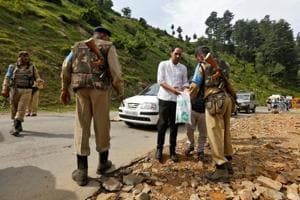 A security force personnel (R) checks the bag of a man near a base camp of Hindu pilgrimage to the cave of Amarnath after seven Hindu pilgrims were killed in a gunbattle between Indian police and militants on Monday.