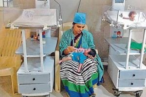 Sabita Baria, 22, with her newborn at the special newborn care unit at the Government JP Hospital in Bhopal, Madhya Pradesh. Her child, a boy, has recovered from birth asphyxia from prolonged labour.