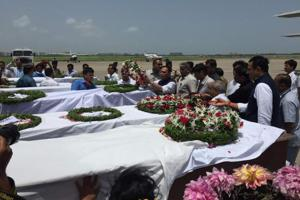 Bodies of the victims of terrorist attack on Amarnath yatris arrive at the airport in Surat, on July 11, 2017.