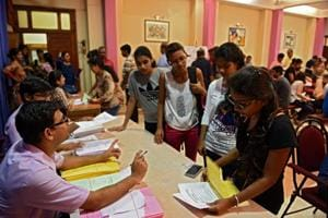Children collecting admission from at KC college in Mumbai, India, on Tuesday, July 11.