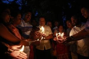 Members of Sambhaji Brigade Maraatha Seva Sangh participate in a candle march for Kopardi rape and murder case victim which completes one year in Pune .