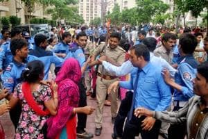 Residents of an apartment complex in Noida woke up to a riot-like situation on Wednesday morning, when a mob stormed its gates and vandalised the premises alleging that one of its residents had assaulted a domestic help.