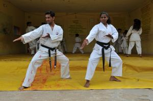 Ritesh Tiwari, 28, and Manna Mandlekar, 23, teach judo at a government school in Harda, in the Madhya Pradesh heartland.