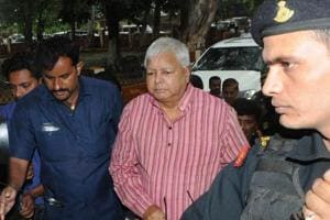 RJD president Lalu Prasad proceeding to appear before a special CBI court in Ranchi
