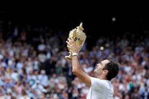 Switzerland's Roger Federer poses with the Wimbledon trophy as he celebrates winning the final against Croatia's Marin Cilic on Sunday.