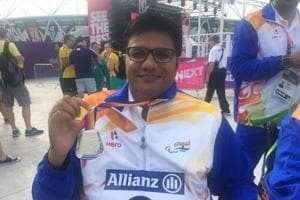 Amit Saroha poses with his medal after winning the silver at the World Para Athletics Championships.
