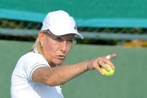Martina Navratilova has 18  Grand Slam titles (a tie with her great rival Chris Evert). She also has a total of 56 grand slam titles including her doubles and mixed doubles wins