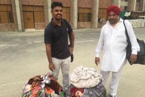 Driver Ranjit Singh (right) and conductor Sukhwinder Singh outside the Faridkot Jail .