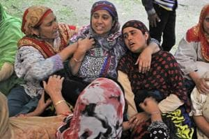 The wife and mother of Naik Mudassar Ahmad weep while waiting for his body in Buchoo village of Tral, 40kms from Srinagar, onTuesday.