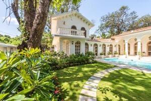 Semi-covered verandas and courtyards at Isprava's Villa Evora in Goa.