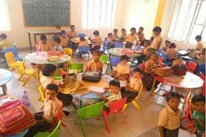 Classrooms of Girls' Upper Primary School in Alwar's Shivaji Park were spruced up, walls painted in bright colours and new furniture added