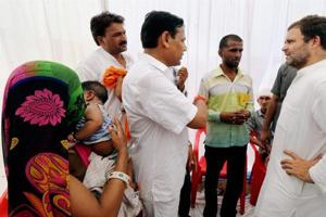Banswara: Congress vice president Rahul Gandhi meets with the family members of the farmers who committed sucide, during the