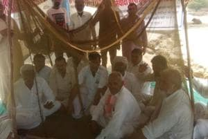 Villagers in Rajasthan hold protest under mosquito nets as menace gets...