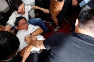 Why Taiwan's politicians shoved, threw water on each other in...