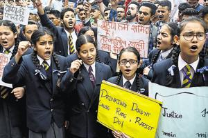 Students take part in a rally demanding a fair probe into the rape and murder of teenage girl, in Shimla on Tuesday.