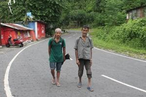 Out of work because of the bandh in Darjeeling hills, wage labourers Ajay Rai (left) and Asok Thapa hunt for food inside Sukna forest every day.
