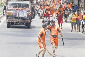 A group of Kanwariyas on the move. Traffic snarls are common on the roads that the Kanwariyas take for their pilgrimage.