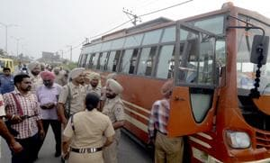 Police officials at the spot of the crime at Nangli in Amritsar on Friday.