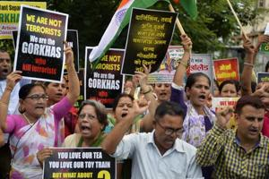 Supporters of the Gorkhaland movement chant slogans during an indefinite strike at Milanmore village in Darjeeling district on the outskirts of Siliguri on July 22,2017.